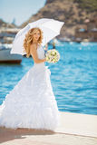 Beautiful bride in wedding dress with white umbrella, outdoors p Royalty Free Stock Photography
