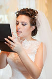 Beautiful bride in a wedding dress Royalty Free Stock Photos
