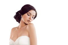 Beautiful bride. Wedding hairstyle make-up luxury fashion dress concept. Beauty portrait of bride wearing wedding dress with feathers with luxury delight make-up stock photography