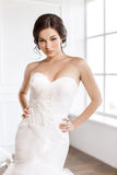 Beautiful bride. Wedding hairstyle make-up luxury fashion dress concept Stock Image