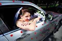 Beautiful bride in a wedding limousine Royalty Free Stock Images