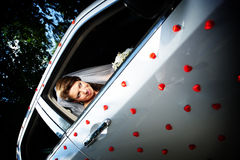 Beautiful bride in a wedding limousine Royalty Free Stock Image
