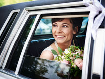 Beautiful bride in wedding limousine Royalty Free Stock Photos