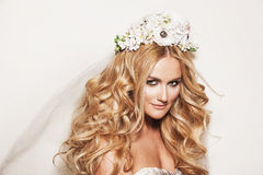Beautiful bride with wedding makeup. Portrait of affectionate blond woman. Beautiful bride with wedding makeup, hairdo and wedding decorations. Wedding ideas and Stock Photography