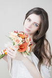 Beautiful bride with wedding orange bouquet Royalty Free Stock Image