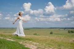 Beautiful bride on wedding walk Stock Photos