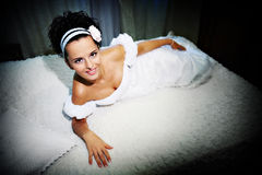 Beautiful bride on white bed Royalty Free Stock Photo