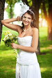Beautiful bride in a white dress Stock Image