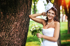 Beautiful bride in a white dress Stock Images