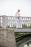 Beautiful bride in white dress on bridge Royalty Free Stock Photos
