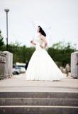 Beautiful bride in white dress on bridge witch umbrella Stock Image