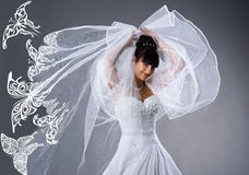 Beautiful bride in a white dress with butterflies Royalty Free Stock Image