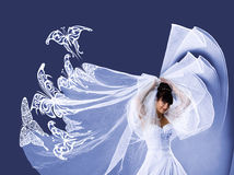 Beautiful bride in a white dress with butterflies Royalty Free Stock Photo