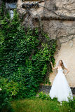 Beautiful bride in a white dress outdoors Stock Photography