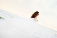 Beautiful bride. In the white dress at the sea Stock Images
