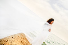 Beautiful bride. In the white dress at the sea Stock Photo