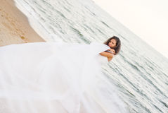 Beautiful bride. In the white dress at the sea Stock Image