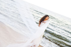 Beautiful bride. In the white dress at the sea Royalty Free Stock Images