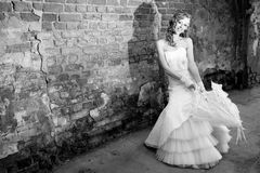 Beautiful bride in white dress with umbrella Royalty Free Stock Photos