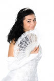 Beautiful bride with white fan Stock Photography