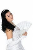 Beautiful bride with white fan Stock Photos