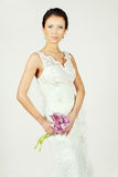 Beautiful bride in white gown Stock Photography