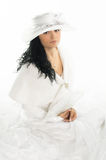 Beautiful bride with white hat, fan and white cape Royalty Free Stock Photo