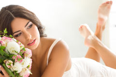 Beautiful bride in white lingerie Stock Photos