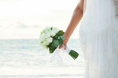 A beautiful bride with white roses Stock Photography