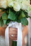 A beautiful bride with white roses Royalty Free Stock Image