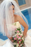 Beautiful bride in white smiling stock photography