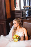 Beautiful bride in white wedding dress with bridal bouquet Stock Image
