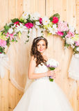 Beautiful bride in white wedding dress with bridal bouquet Stock Photos