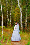 Beautiful bride in white wedding dress in forest. royalty free stock photography