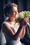 Beautiful bride. In white wedding dress standing in  near the window Stock Photos