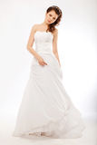 Beautiful bride in white wedding long dress posing Stock Photography