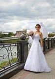 Beautiful bride wiht umbrella Stock Photo