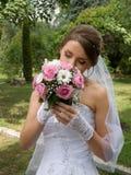 Beautiful bride wiht wedding flowers Stock Image
