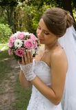 Beautiful bride wiht wedding flowers Royalty Free Stock Photography