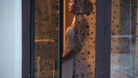 Beautiful bride in the window. Sequence stock video footage