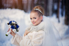 Beautiful bride in the winter forest. Bright winter wedding photo Royalty Free Stock Images