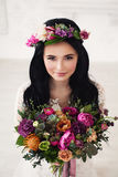 Beautiful Bride Woman with Colorful Flower Arrangement Stock Photography