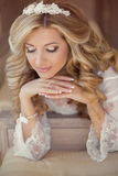 Beautiful bride woman indoor portrait. Makeup and wavy hair styl Royalty Free Stock Images