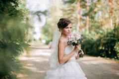 Beautiful bride woman portrait with bridal bouquet posing in her. Wedding day Stock Image