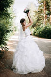 Beautiful bride woman portrait with bridal bouquet posing in her. Wedding day Royalty Free Stock Image