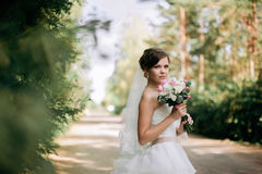 Beautiful bride woman portrait with bridal bouquet posing in her. Wedding day Stock Images