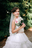 Beautiful bride woman portrait with bridal bouquet posing in her. Wedding day Royalty Free Stock Photos