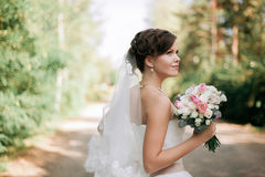 Beautiful bride woman portrait with bridal bouquet posing in her. Wedding day Royalty Free Stock Photography