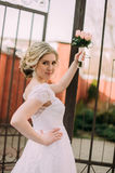 Beautiful bride woman portrait with bridal bouquet posing in her wedding day Royalty Free Stock Image