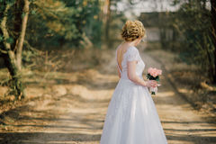 Beautiful bride woman portrait with bridal bouquet posing in her wedding day.  Royalty Free Stock Photo